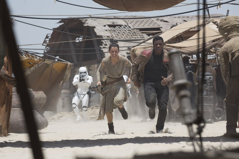 Finn and Rey being pursued by Stormtroopers on Jakku