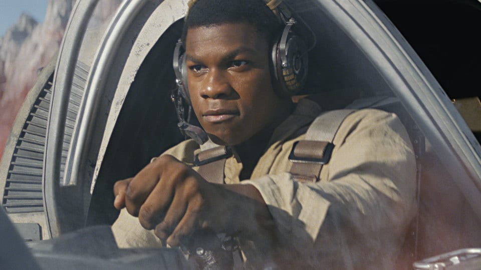 Finn from Star Wars flying a starfighter