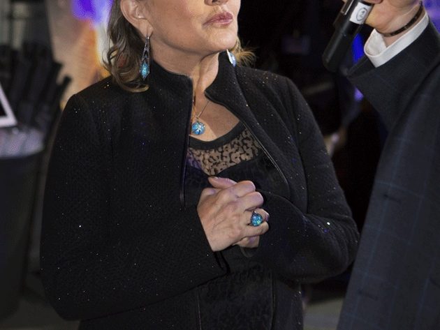 Carrie Fisher, Princess (now General) Leia, attended the premiere with her beloved French bulldog...