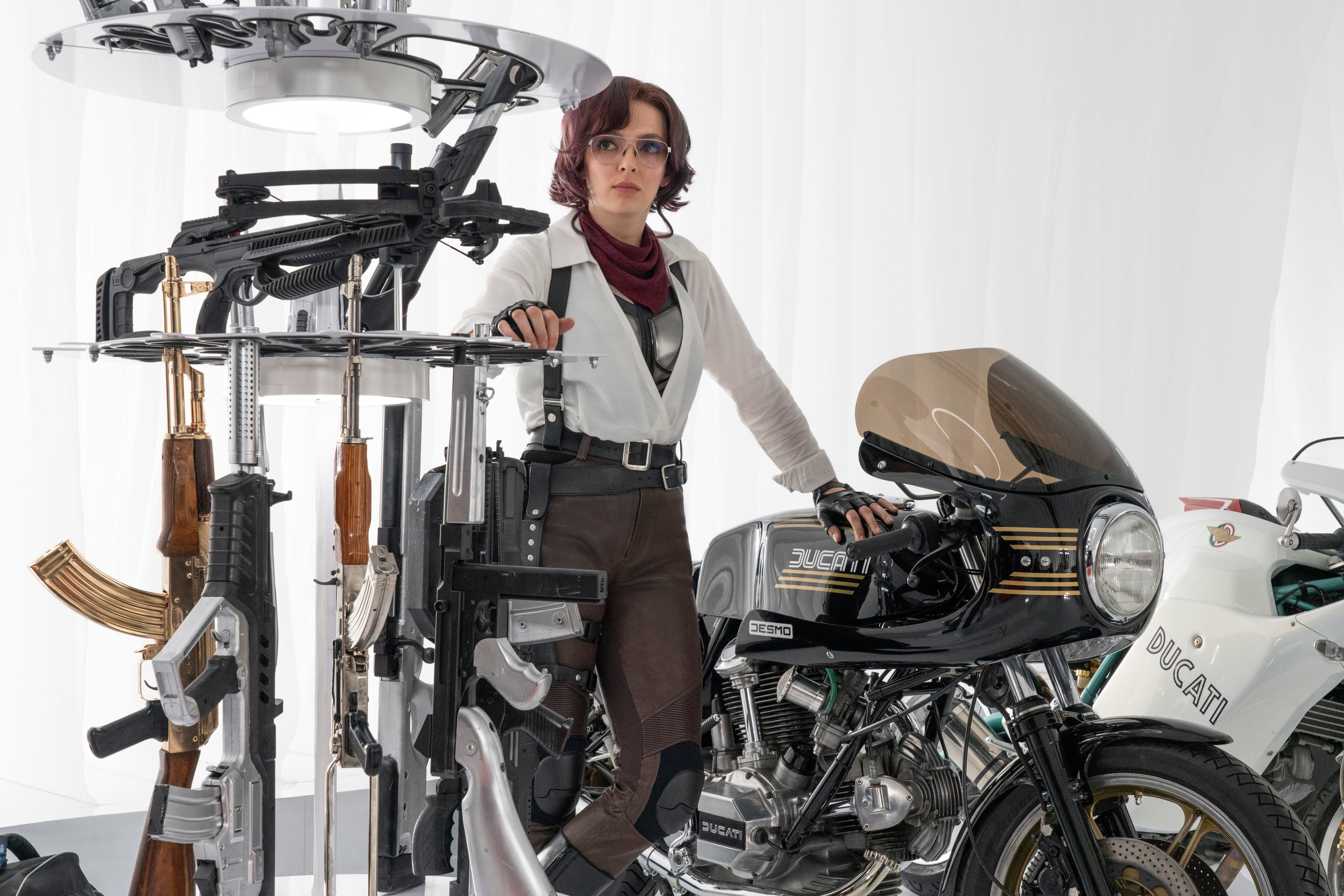 Jodie Comer leans up against a motorcycle in a scene from Free Guy