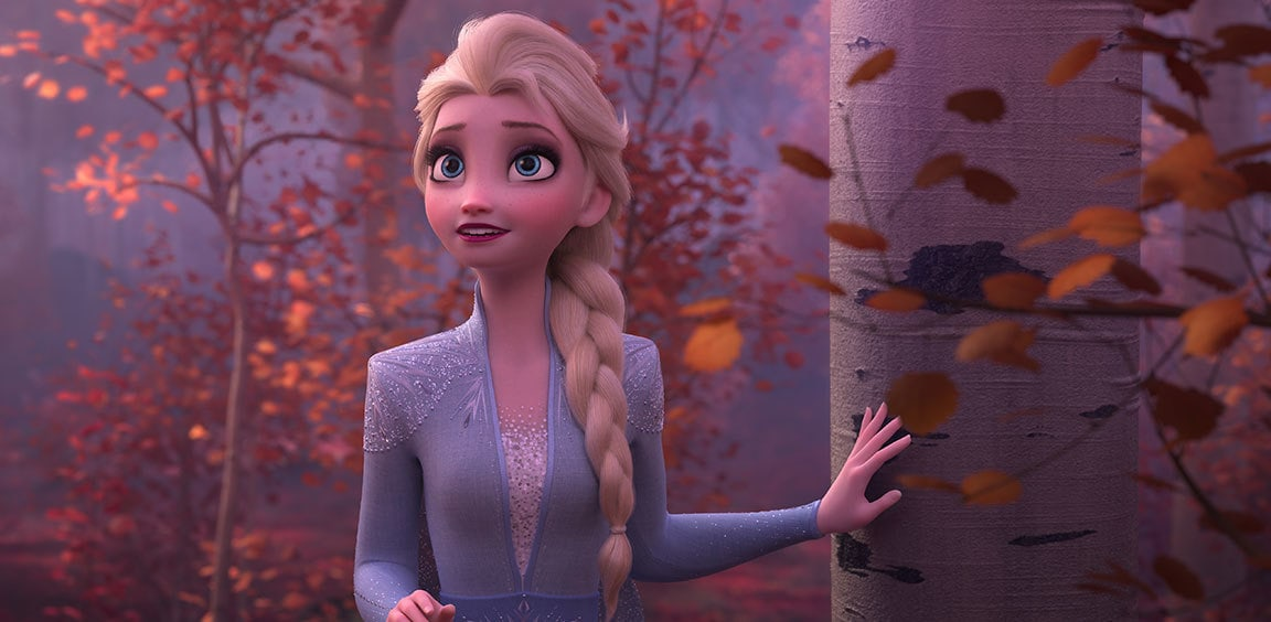 Elsa standing in a forest
