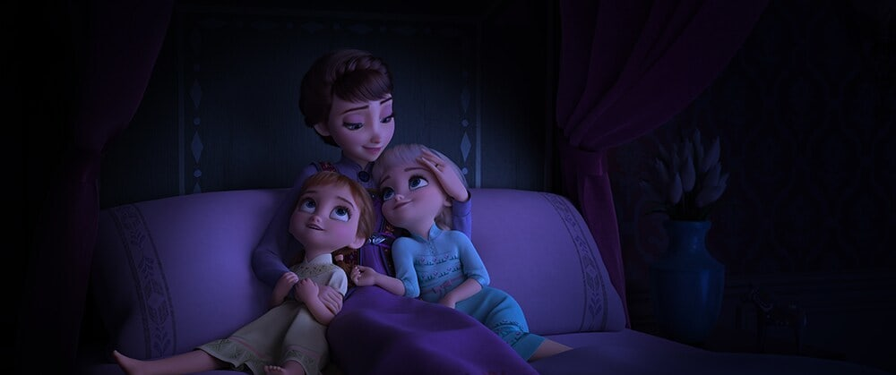 Queen Iduna, Anna and Elsa's mother, hugging young Anna and Elsa
