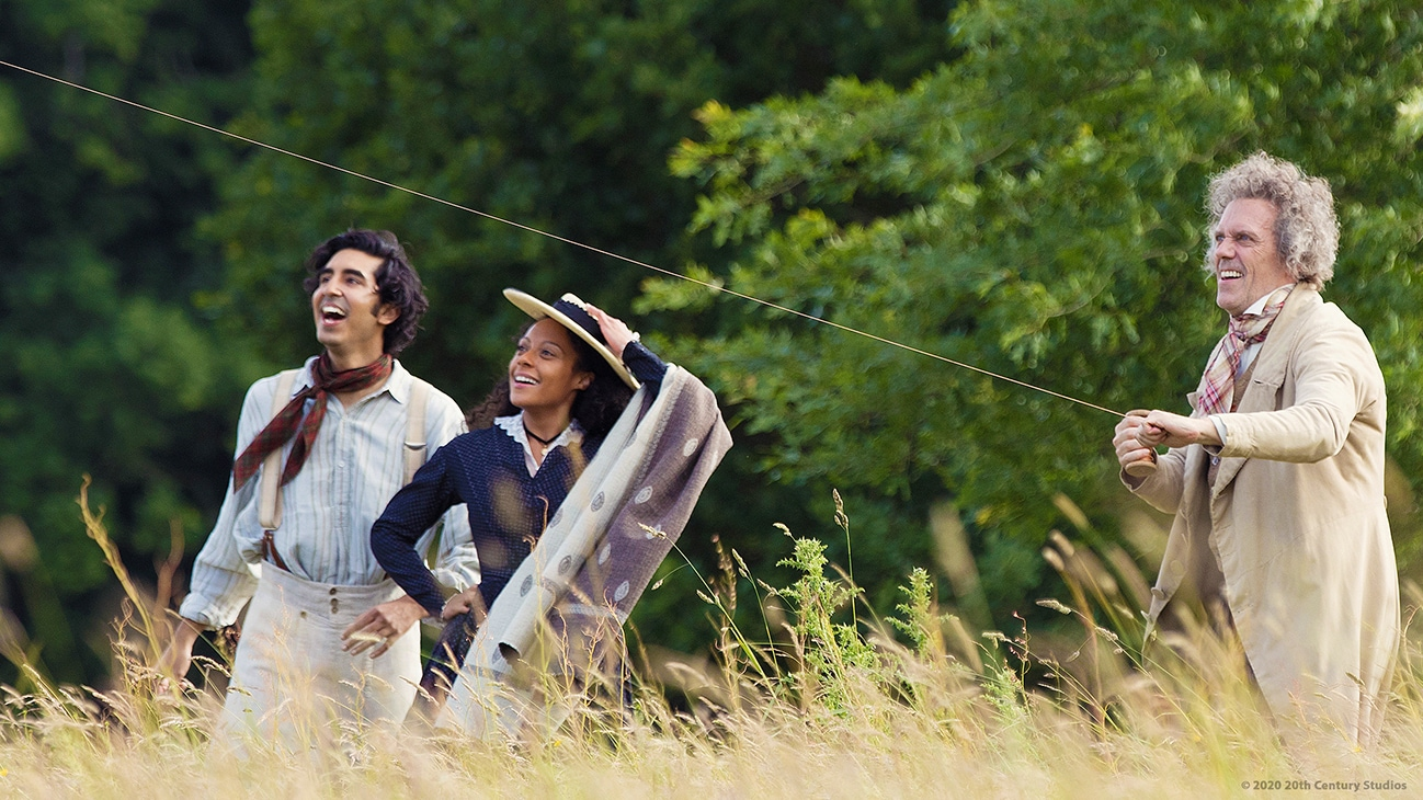 "Actors Dev Patel, Rosalind Eleazar, and Peter Capaldi in the movie ""The Personal History of David Copperfield"""