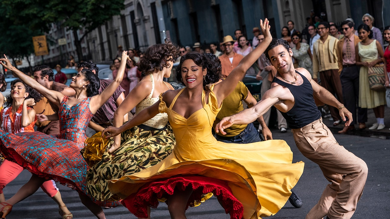 """Actor Ariana DeBose dancing in the street with others from the 20th Century Studios movie """"West Side Story""""."""