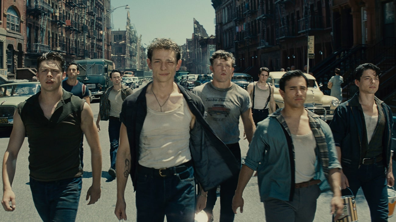 """An image of actors Sean Harrison Jones, Patrick Higgins, Jess LeProtto, Kevin Csolak, and Mike Faist walking down a street from the 20th Century Studios movie """"West Side Story""""."""