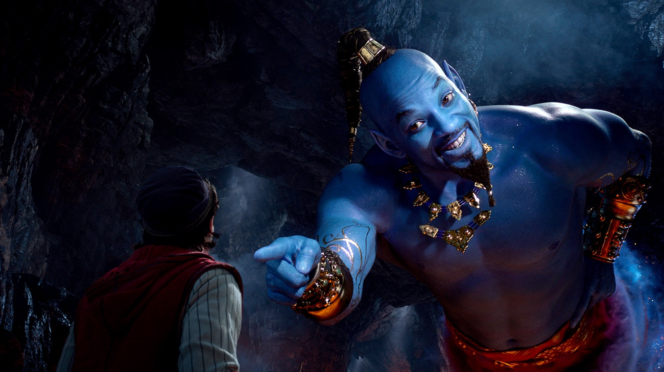 Mena Massoud (as Aladdin) and Will Smith (as Genie) in the cave of wonders