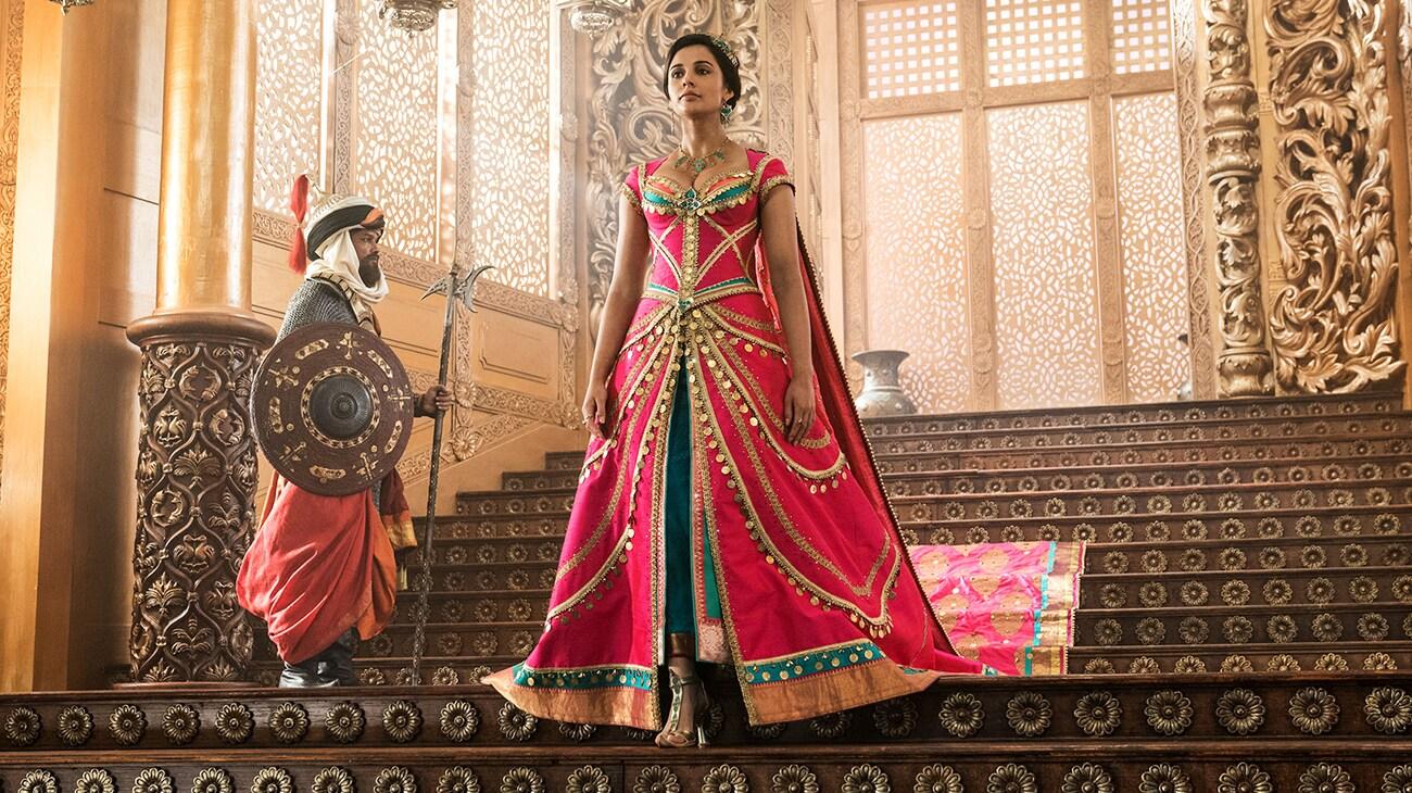 Naomi Scott (as Princess Jasmine) walking down the stairs.