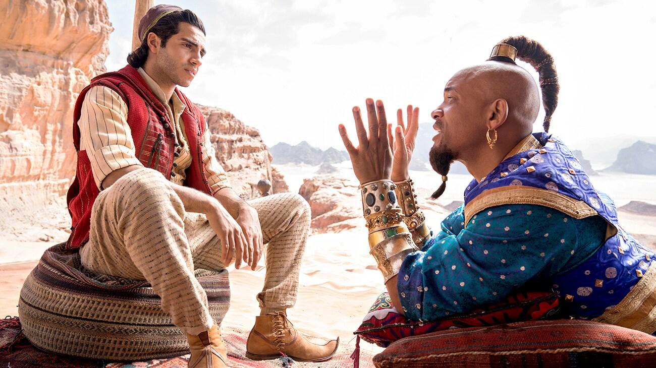 Mena Massoud (as Aladdin) and Will Smith (as Genie) in Aladdin