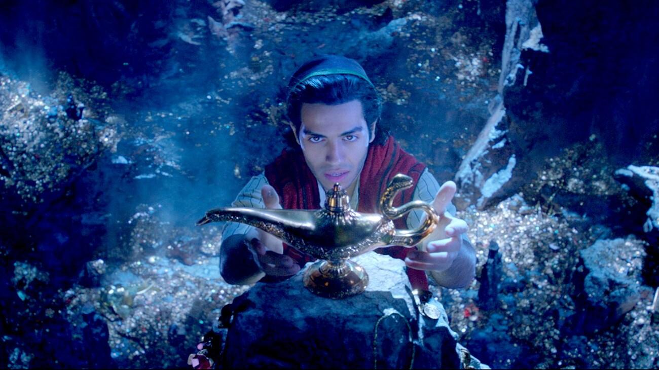Mena Massoud (as Aladdin) reaching for the magic lamp in Aladdin