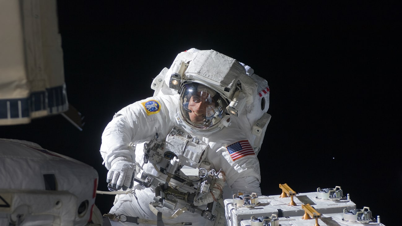 """AMONG THE STARS - (27 July 2009) - Astronaut Christopher Cassidy, STS-127 mission specialist, participates in the mission's fifth and final session of extravehicular activity (EVA) as construction and maintenance continue on the International Space Station. During the four-hour, 54-minute spacewalk, Cassidy and astronaut Tom Marshburn (out of frame), mission specialist, secured multi-layer insulation around the Special Purpose Dexterous Manipulator known as Dextre, split out power channels for two space station Control Moment Gyroscopes, installed video cameras on the front and back of the new Japanese Exposed Facility and performed a number of """"get ahead"""" tasks, including tying down some cables and installing handrails and a portable foot restraint to aid future spacewalkers. (NASA)"""
