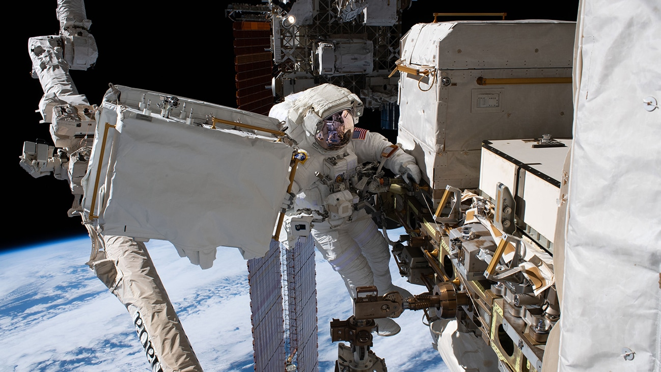 AMONG THE STARS - (Dec. 2, 2019) - NASA astronaut Andrew Morgan is tethered to the International Space Station with the Earth 250 miles below during the third spacewalk to upgrade the Alpha Magnetic Spectrometer's thermal pump system.  (NASA)  ANDREW MORGAN