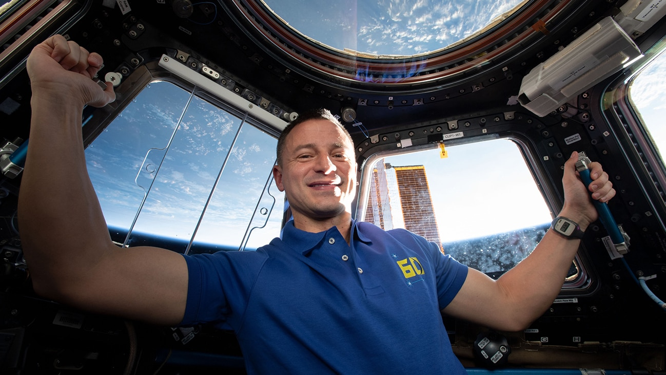 """AMONG THE STARS - (July 23, 2019) -  Expedition 60 Flight Engineer Drew Morgan of NASA is pictured inside the International Space Station's """"window to the world,"""" the seven-windowed Cupola. At the time this photograph was taken, the orbiting lab was flying 261 miles above the Caspian Sea. (NASA) DREW MORGAN"""