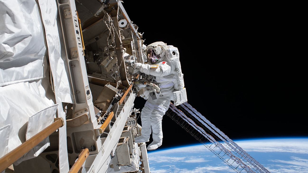 AMONG THE STARS - (Jan. 25, 2020) - ESA (European Space Agency) astronaut Luca Parmitano is pictured tethered to the International Space Station while finalizing thermal repairs on the Alpha Magnetic Spectrometer, a dark matter and antimatter detector, during a spacewalk that lasted 6 hours and 16 minutes. (NASA)  LUCA PARMITANO