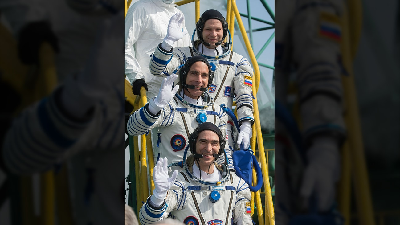 AMONG THE STARS - Expedition 63 crewmembers Ivan Vagner of Roscosmos, top, Chris Cassidy of NASA, center, and Anatoly Ivanishin wave goodbye as they prepare to climb aboard the Soyuz MS-16 rocket at Site 31 at the Baikonur Cosmodrome in Kazakhstan, Thursday, April 9, 2020. They launched a short time later to the International Space Station for the start of a six-and-a-half month mission. (NASA/GCTC/Andrey Shelepin)  IVAN VAGNER, CHRIS CASSIDY, ANATOLY IVANISHIN