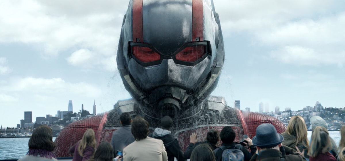 Giant Paul Rudd as Ant-man emerging from water in front of a crowd in the movie Ant-man and the Wasp