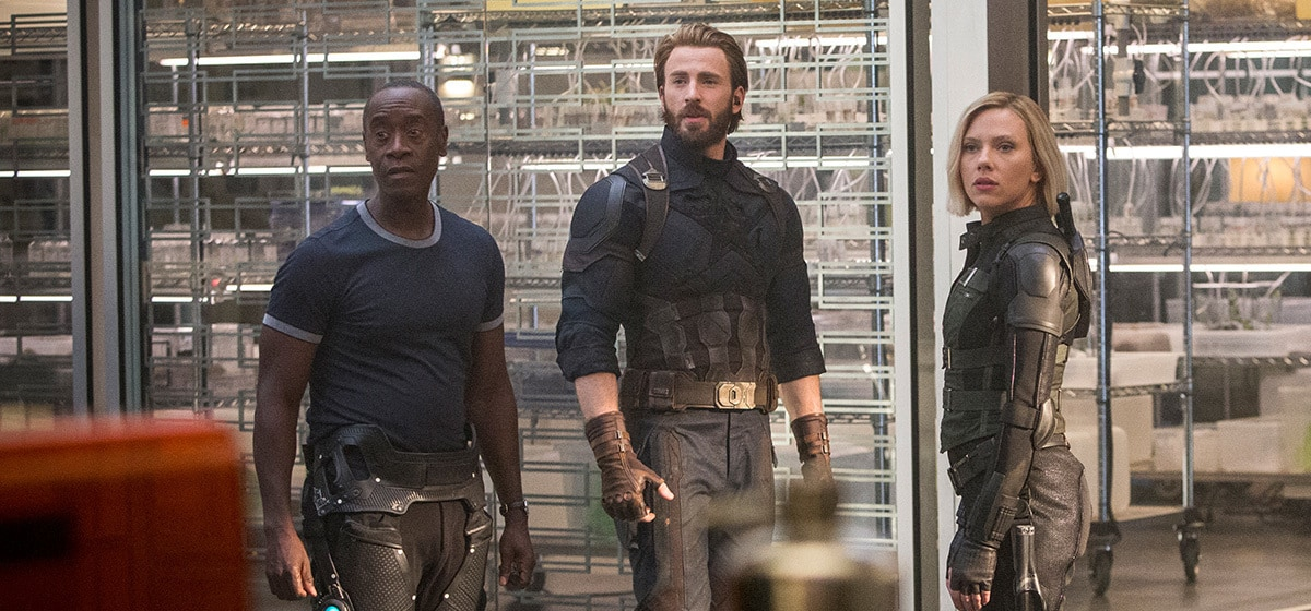 Don Cheadle as James Rhodes, Chris Evans as Captain America, and Scarlett Johansson as Black Widow at headquarters in Avenergs: Infinity War