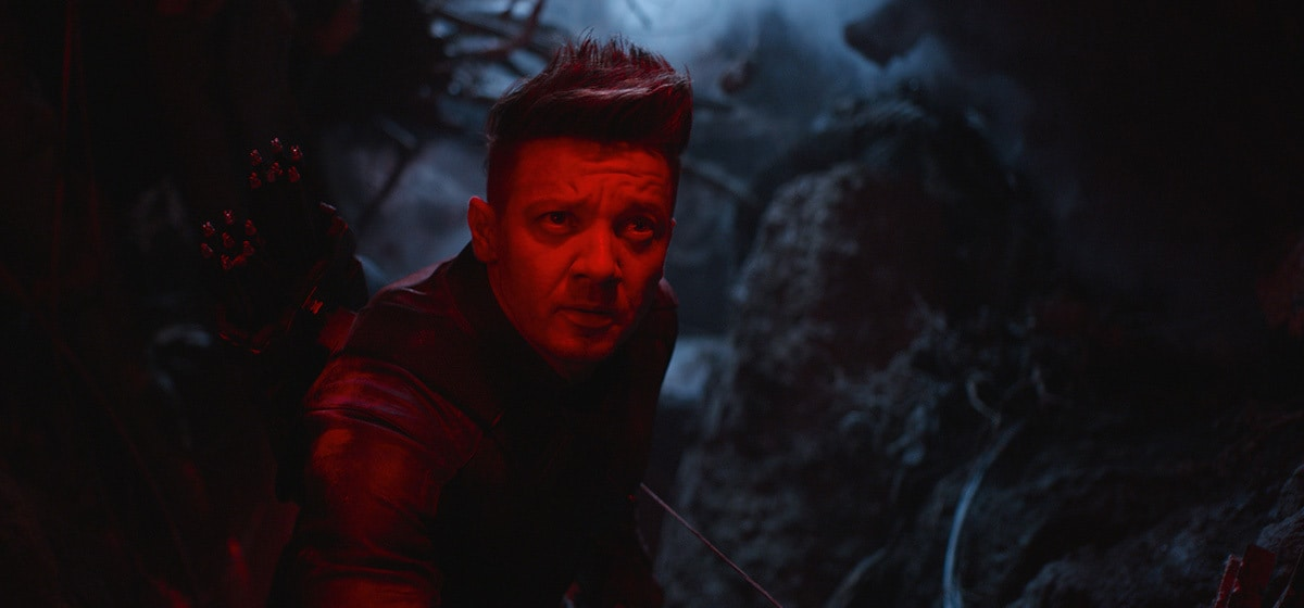 Jeremy Renner, who plays Haweye in Avengers: Endgame, cast in a red light amidst darkness