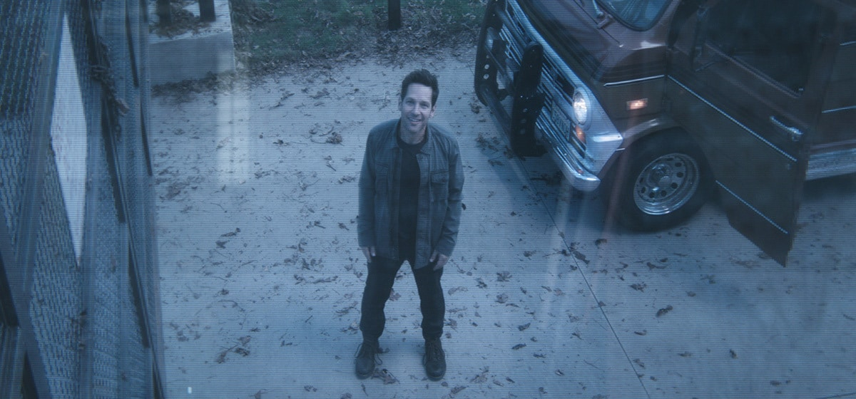 Paul Rudd, who plays Ant-Man in Avengers: Endgame, standing in front of his car looking up at a camera