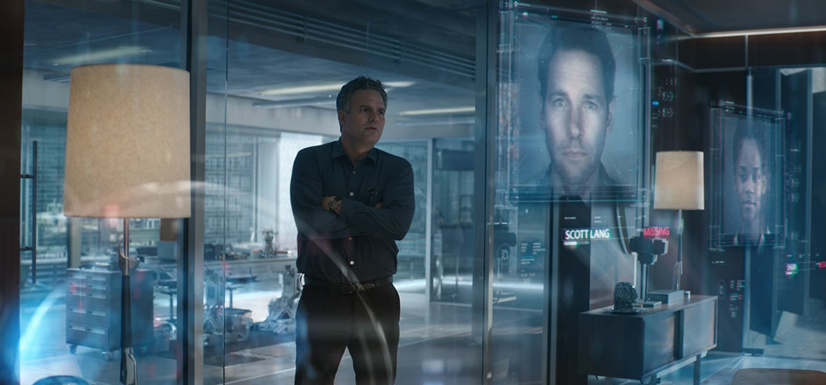 Mark Ruffalo, who plays Bruce Banner/The Hulk in Avengers: Endgame, in Avengers Headquarters looking at an image of Paul Rudd, who plays Ant-Man