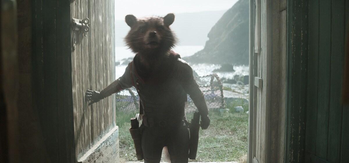 Rocket, voiced by Bradley Cooper, walking through a door in Avengers: Endgame