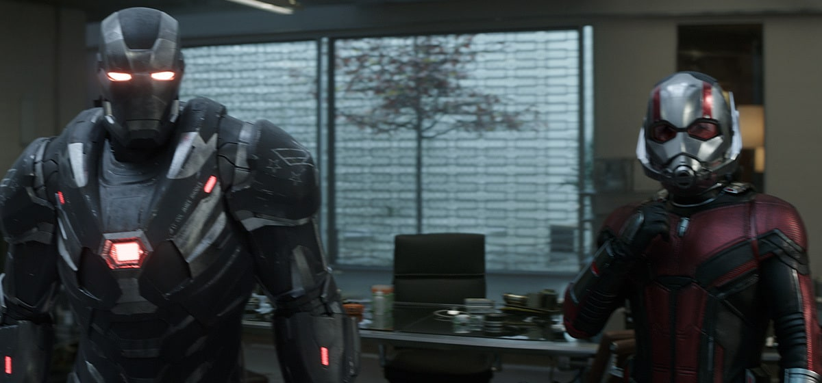 Don Cheadle as War Machine and Paul Rudd as Ant-Man standing in Avengers headquarters in Avengers: Endgame
