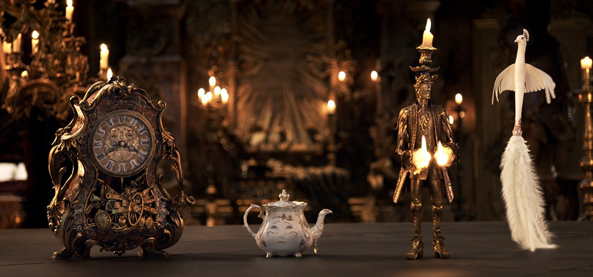 Ewan McGregor (Lumiere), Emma Thompson (Mrs. Pots), Ian McKellen (Cogsworth), and Gugu Mbatha-Raw (Plumette) in Beauty and the Beast
