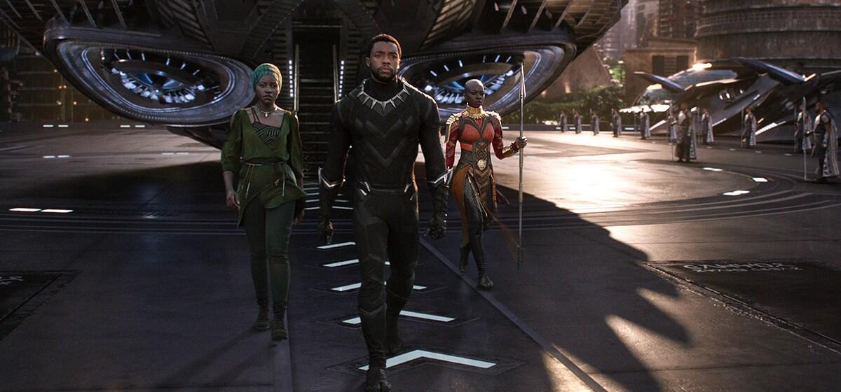 "Chadwick Boseman as Black Panther walking from plane in the film ""Black Panther"""