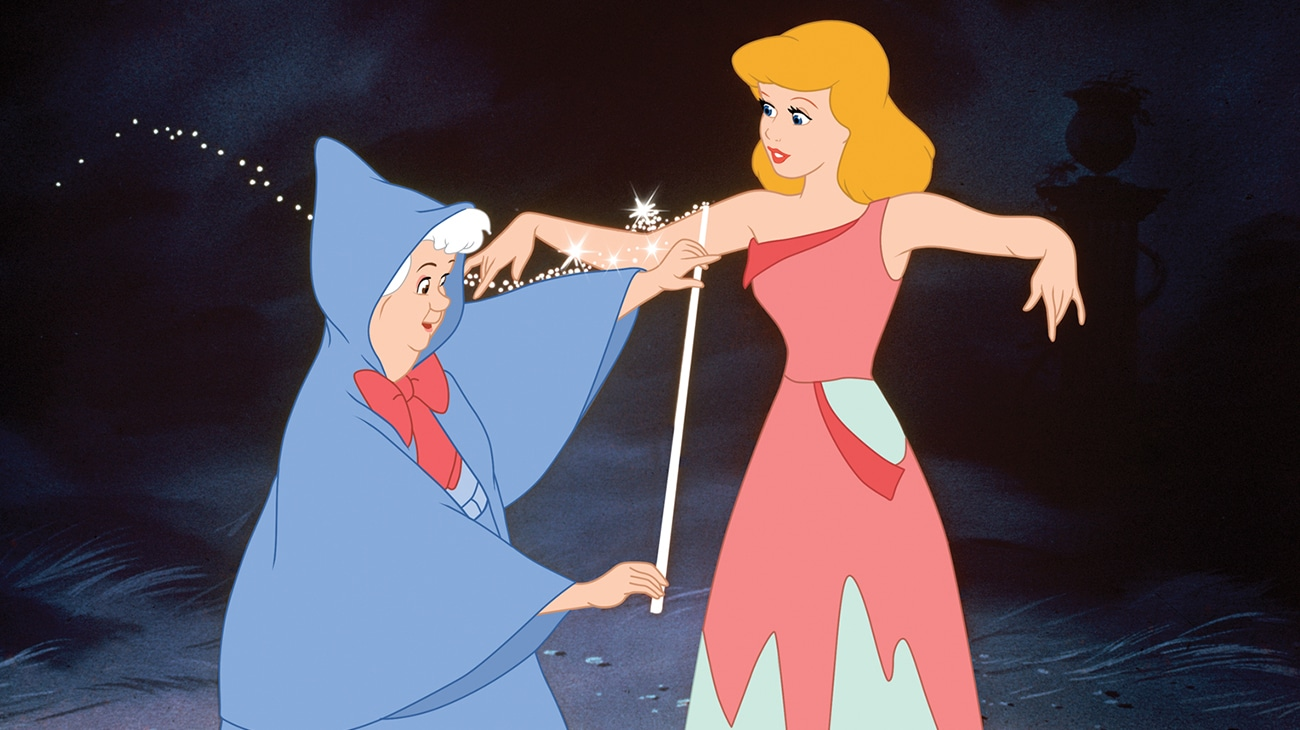 Fairy Godmother preparing to give Cinderella a new dress so she can go to the ball.