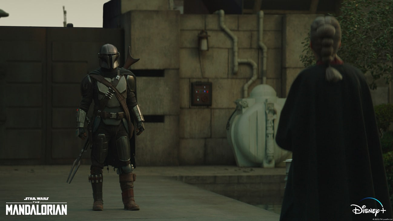 The Mandalorian (Pedro Pascal) and The Magistrate (Diana Lee Inosanto) in Lucasfilm's THE MANDALORIAN, season two, exclusively on Disney+. © 2020 Lucasfilm Ltd. & ™. All Rights Reserved.