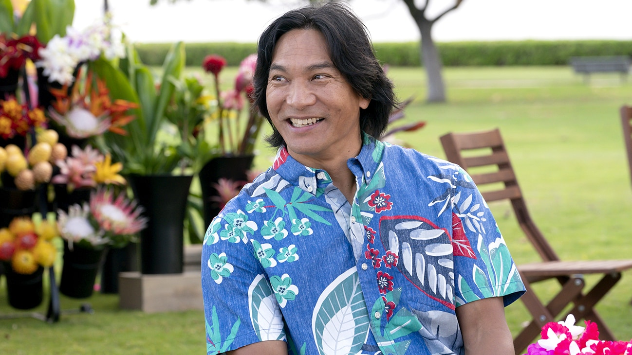 A picture of a man smiling looking off to the side. From the Disney+ Original series Doogie Kamealoha, M.D.
