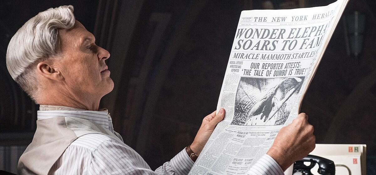 Michael Keaton reads a newspaper in Dumbo