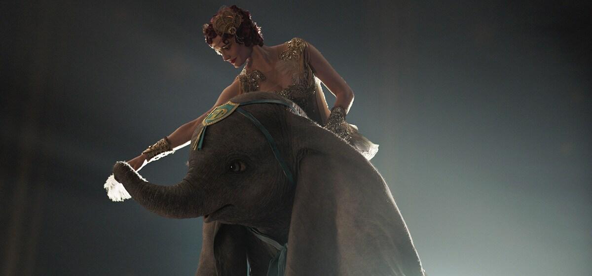 Eva Green (Colette Marchant) rides on Dumbo