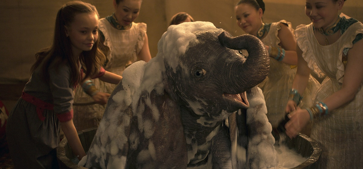 """Nico Parker (Milly Farrier) gives Dumbo a bath from the movie """"Dumbo"""""""