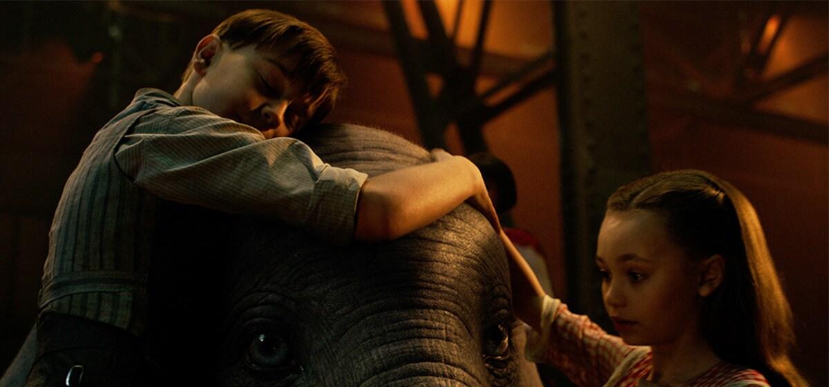 Finley Hobbins (Joe Farrier) and Nico Parker (Milly Farrier) hug Dumbo