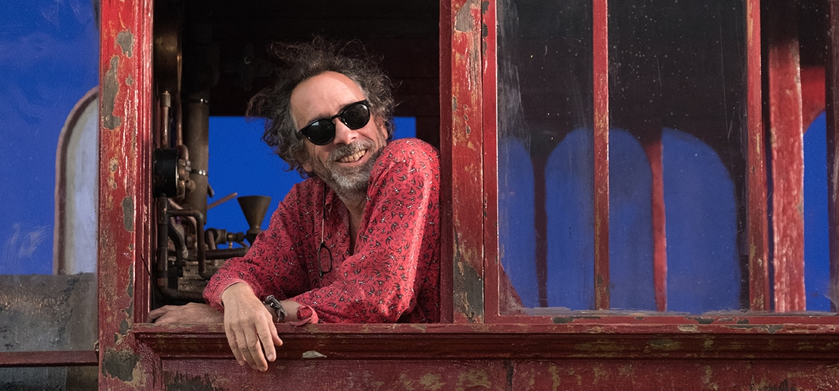 """Tim Burton in the cabin of the train engine from the movie """"Dumbo"""""""