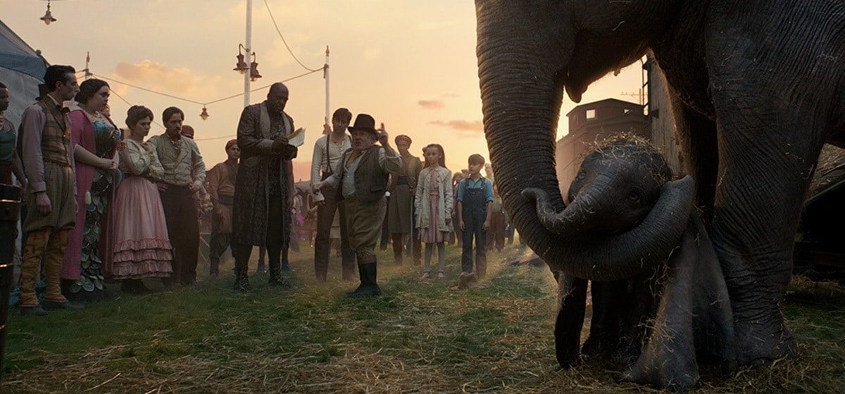 """Max Medici (Danny DeVito) and the rest of the circus team welcomes the newborn elephant from the movie """"Dumbo""""."""