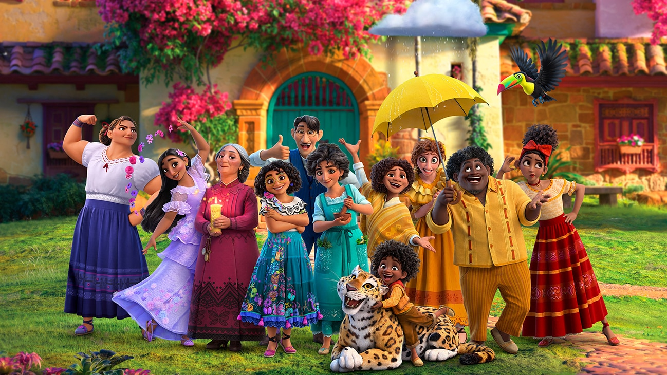 Image of a Mirabel and her extended family posing in front of a house from the Disney movie Encanto.