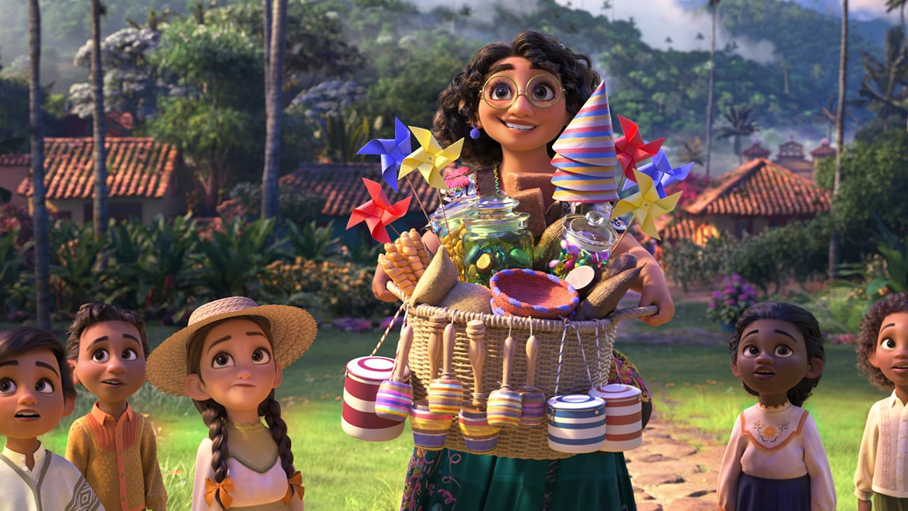 Image of Mirabel holding a basket of party hats, pinwheels, and other objects, surrounded by several children from the Disney movie Encanto.