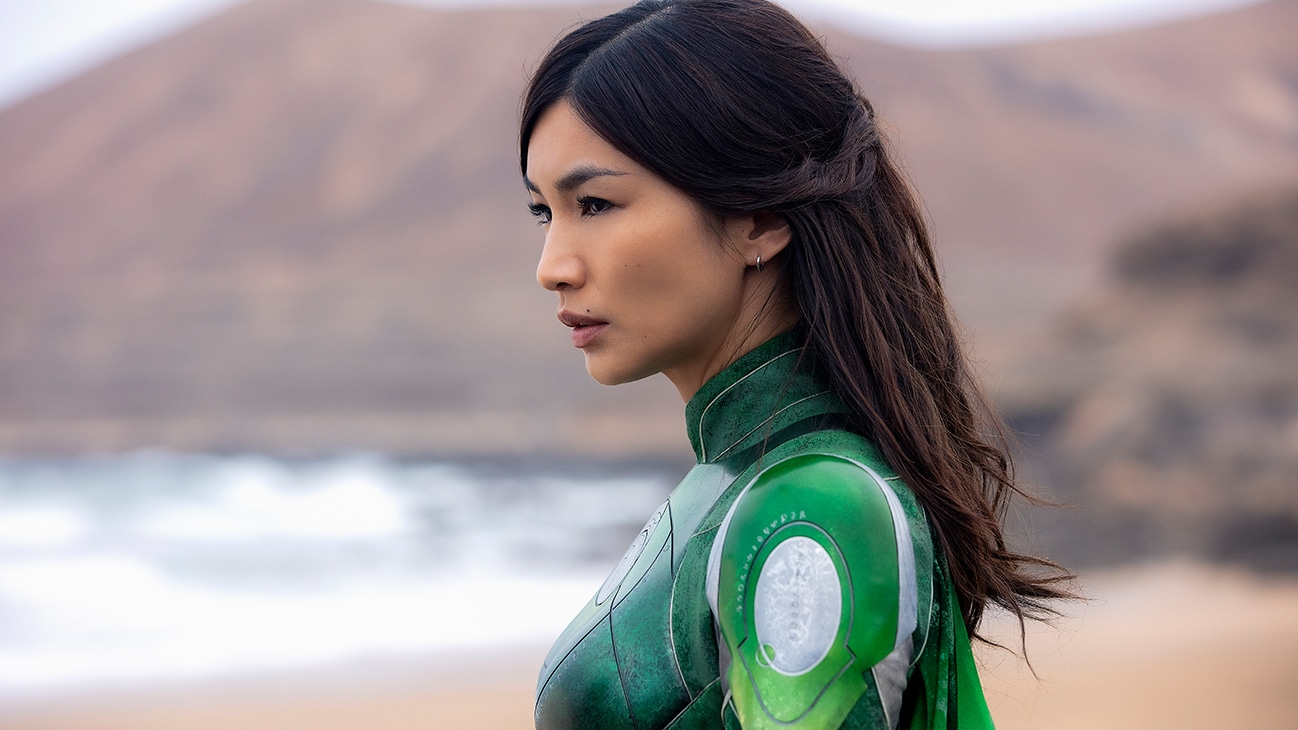 Sersi (actor Gemma Chan) standing on a beach from the Marvel Studios movie Eternals.
