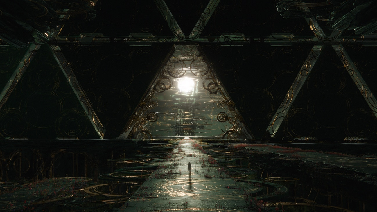 Image of a person walking along a dark and immense open walkway that faces a triangular opening with a bright spherical object in the distance from the Marvel Studios movie Eternals.