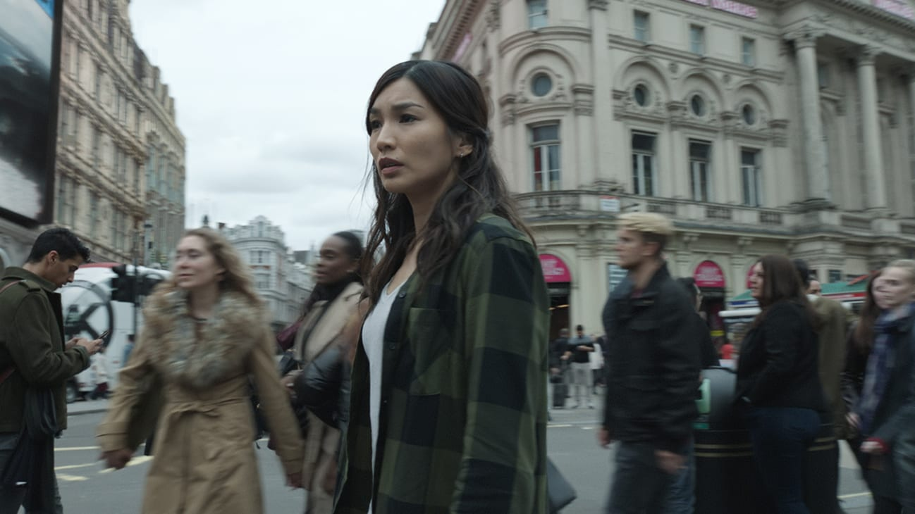 Sersi (actor Gemma Chan) in a street from the Marvel Studios movie Eternals.