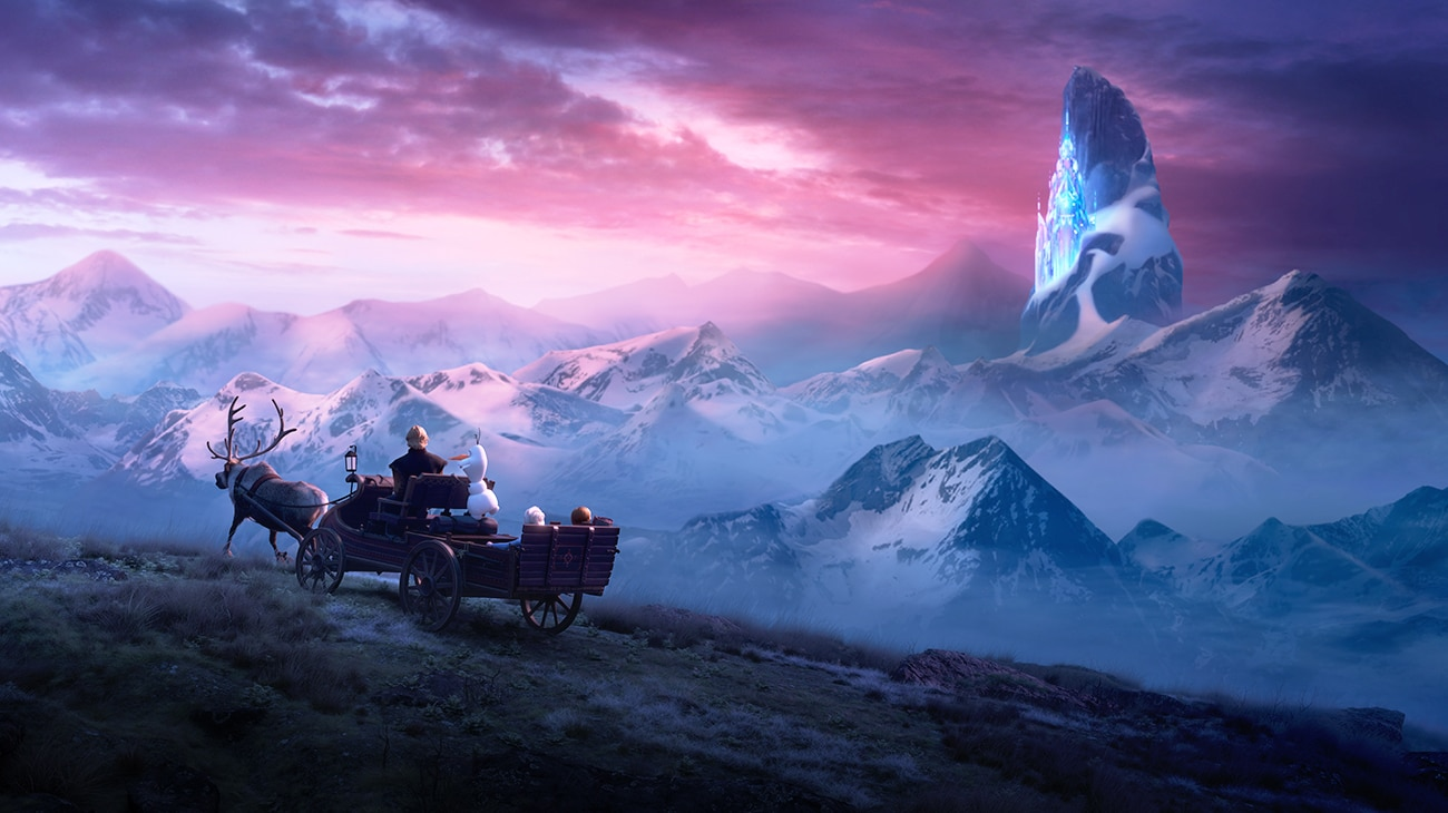 Elsa (voiced by Idina Menzel), Anna (voiced by Kristen Bell), Kristoff (voiced by Johnathan Groff), Olaf (voiced by Josh Gad) ride in a wagon pulled by Sven with Elsa's ice palace in the distance in Frozen 2.