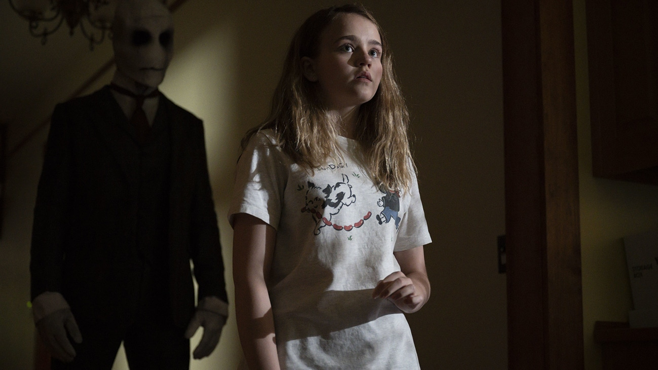 """Actor Megan Stott standing in a dimly lit hallway from the Just Beyond episode """"My Monster"""". (Disney/Tom Griscom)"""