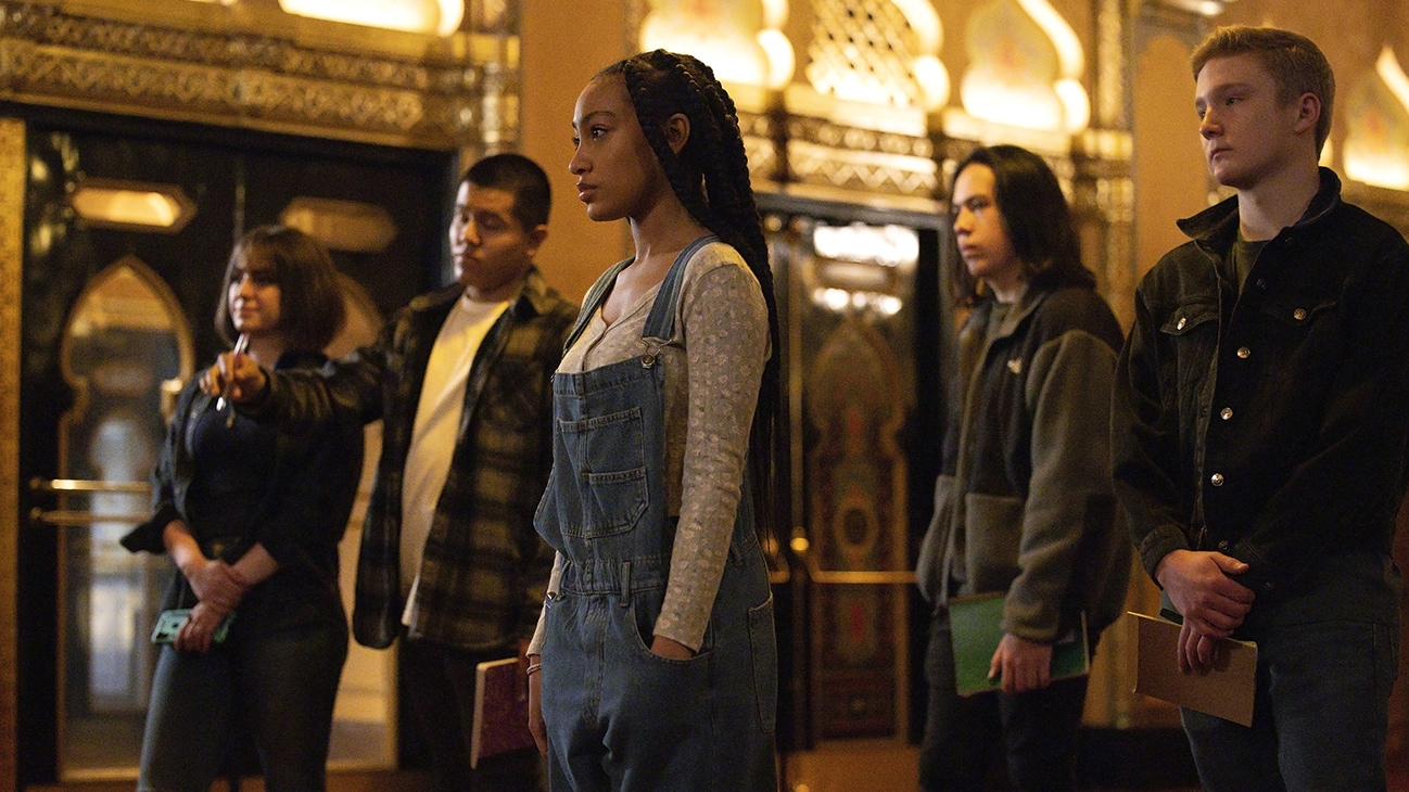"""Lexi Underwood standing with a group of people from the Disney Just Beyond episode """"We've Got Spirits, Yes We Do"""". (Disney/Fernando Decillis)"""