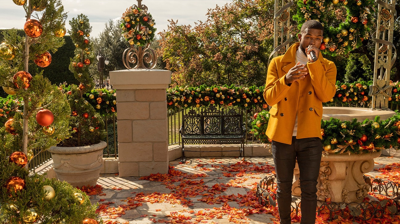 """Trevor Jackson performs at Magic Kingdom Park at Walt Disney World Resort in Lake Buena Vista, Fla., Thursday, Dec. 3, 2020, during a taping of """"The Disney Parks Magical Christmas Celebration."""" The holiday special will air on ABC on Dec. 25, 10am-12pm ET. (Kent Phillips, photographer)"""