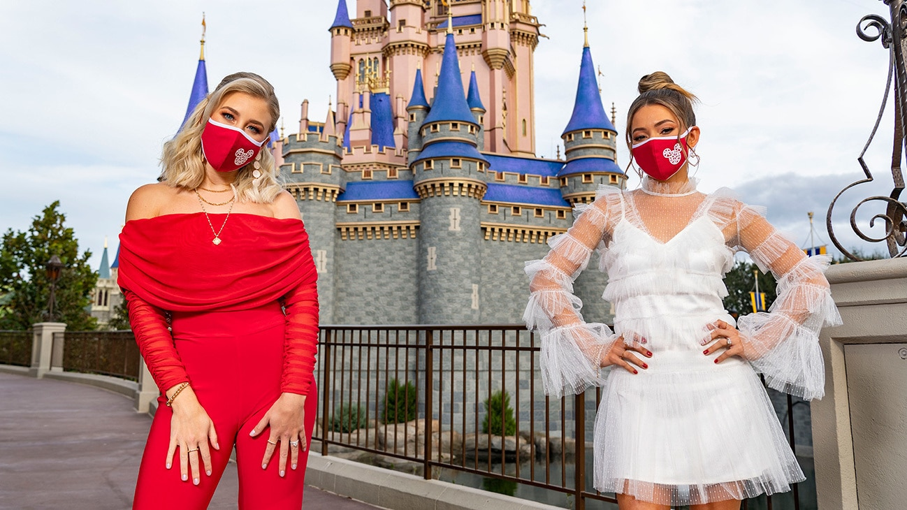 """Country duo Maddie & Tae sparkle with the joy of the holidays in front of Cinderella Castle at Magic Kingdom Park at Walt Disney World Resort in Lake Buena Vista, Fla., Thursday, Dec. 3, 2020, during a taping of """"The Disney Parks Magical Christmas Celebration."""" The holiday special will air on ABC on Dec. 25, 10am-12pm ET. (Matt Stroshane, photographer)"""
