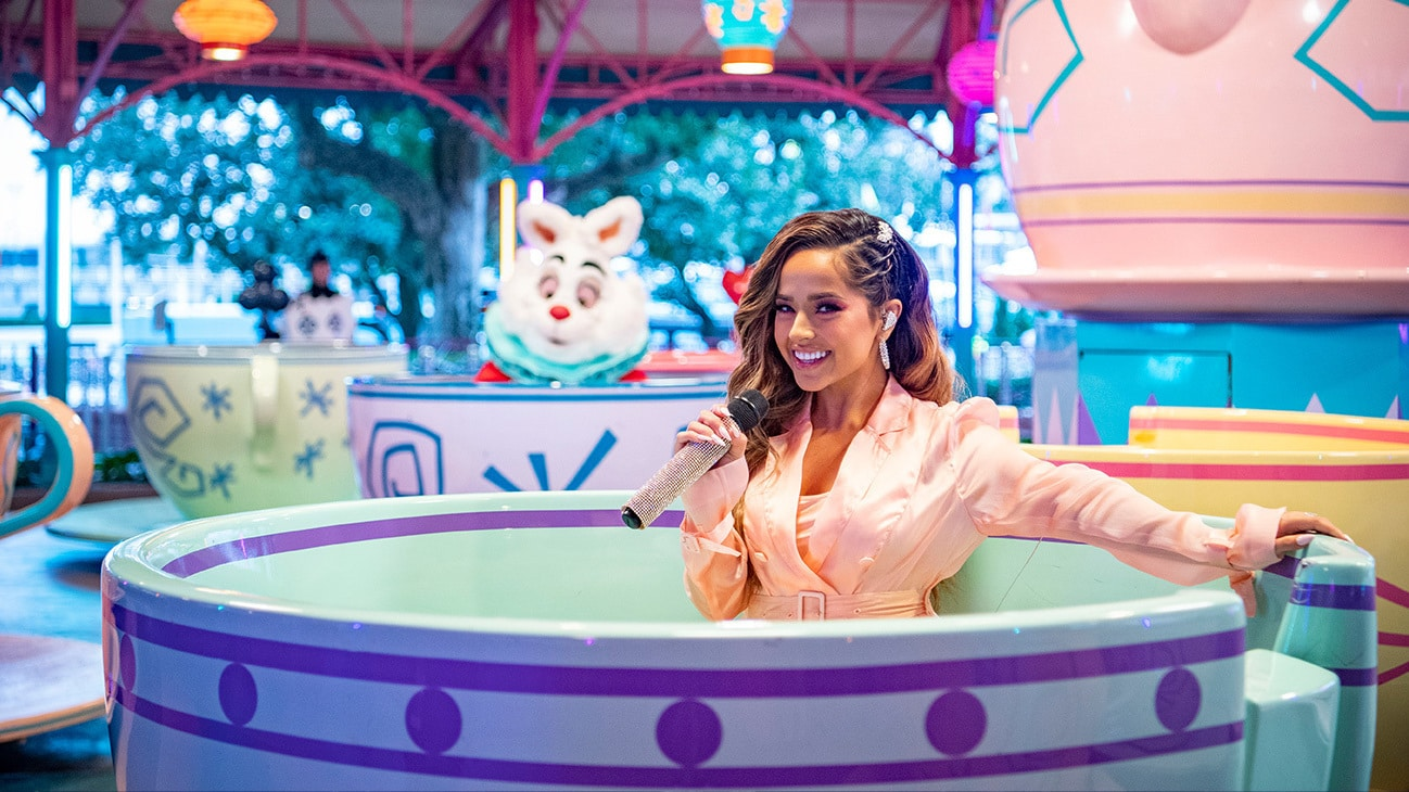 """Singer, songwriter, and actress Becky G performs from the Mad Tea Party at Magic Kingdom Park at Walt Disney World Resort in Lake Buena Vista, Fla., Friday, Dec. 4, 2020, during a taping of """"The Disney Parks Magical Christmas Celebration."""" The holiday special will air on ABC on Dec. 25, 10am-12pm ET. (Matt Stroshane, photographer)"""