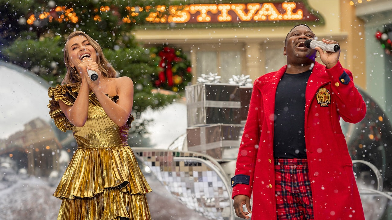 """Julianne Hough and Tituss Burgess perform together during a taping of """"The Disney Parks Magical Christmas Celebration"""" from Magic Kingdom Park at Walt Disney World Resort in Lake Buena Vista, Fla. on Friday, Dec. 4, 2020. The holiday special will air on ABC on Dec. 25, 10am-12pm ET. (Kent Phillips, photographer)"""