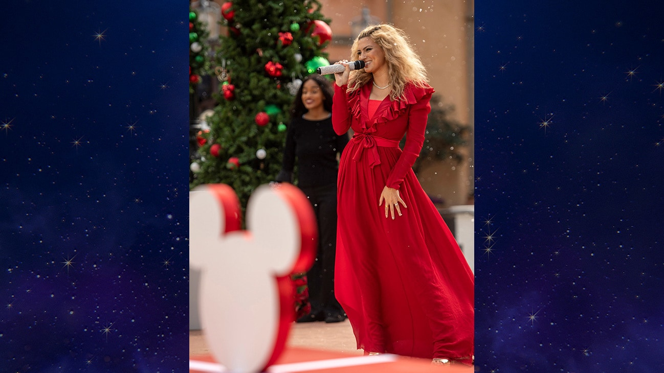 """Tori Kelly performs with the Florida A&M University Choir at EPCOT at Walt Disney World Resort in Lake Buena Vista, Fla. on Saturday, Dec. 5, 2020, during a taping of """"The Disney Parks Magical Christmas Celebration."""" The holiday special will air on ABC on Dec. 25, 10am-12pm ET. (Kent Phillips, photographer)"""