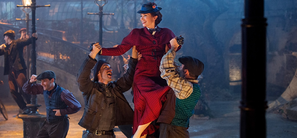 """Emily Blunt in Mary Poppins dancing in the streets in """"Mary Poppins Returns"""""""